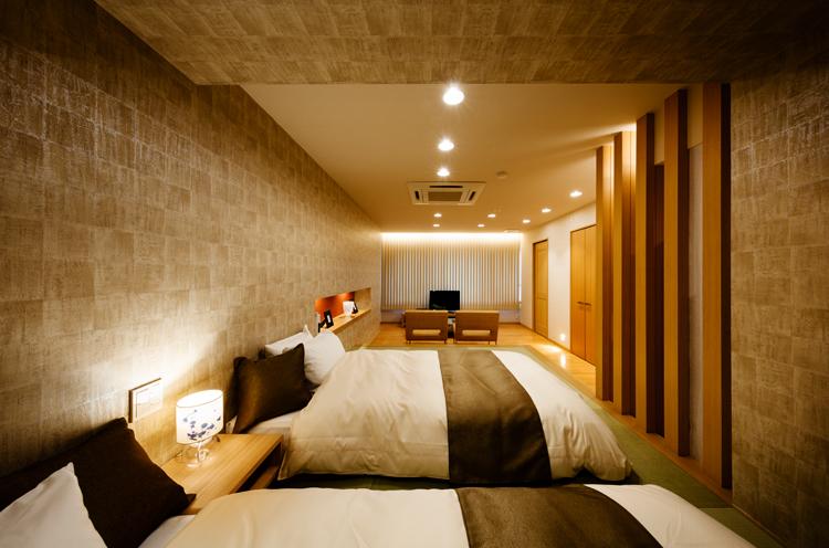 「プレミアムツイン・リビング付和洋室」。ほかさまざまなタイプの客室を用意しています