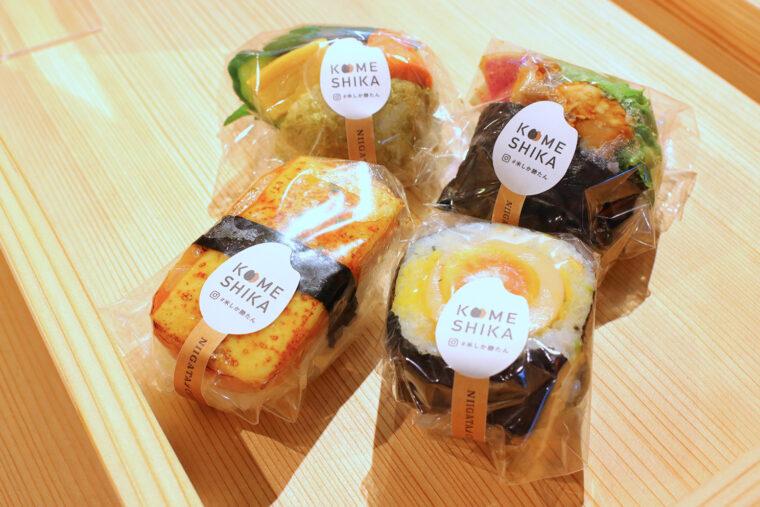 料理研究家の佐藤智香子さんとコラボし、新潟の美味しいお米をかわいく彩った新感覚のおむすびがたくさん並ぶ